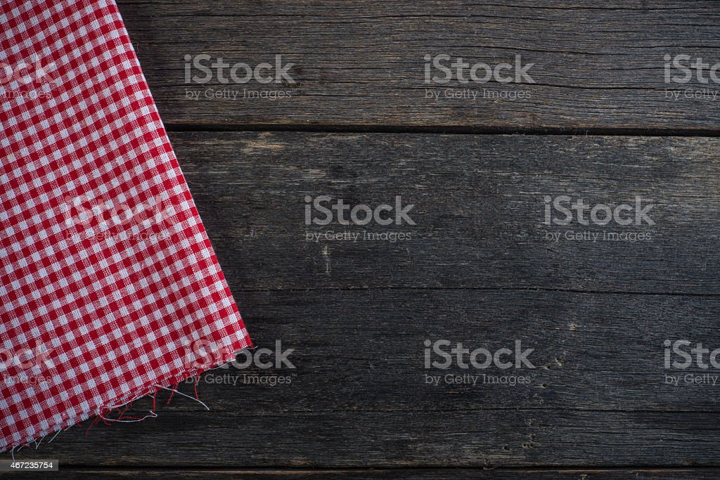 Kitchen cloth on rustic wood background template stock photo