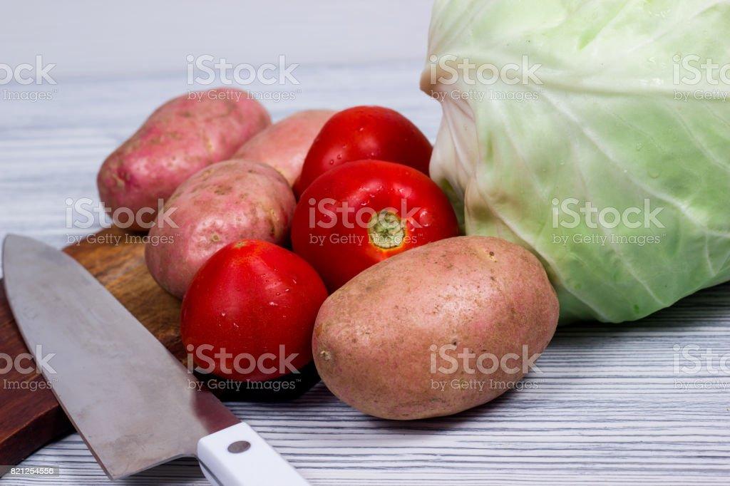 Kitchen, cooking, potato, knife, cutting board stock photo