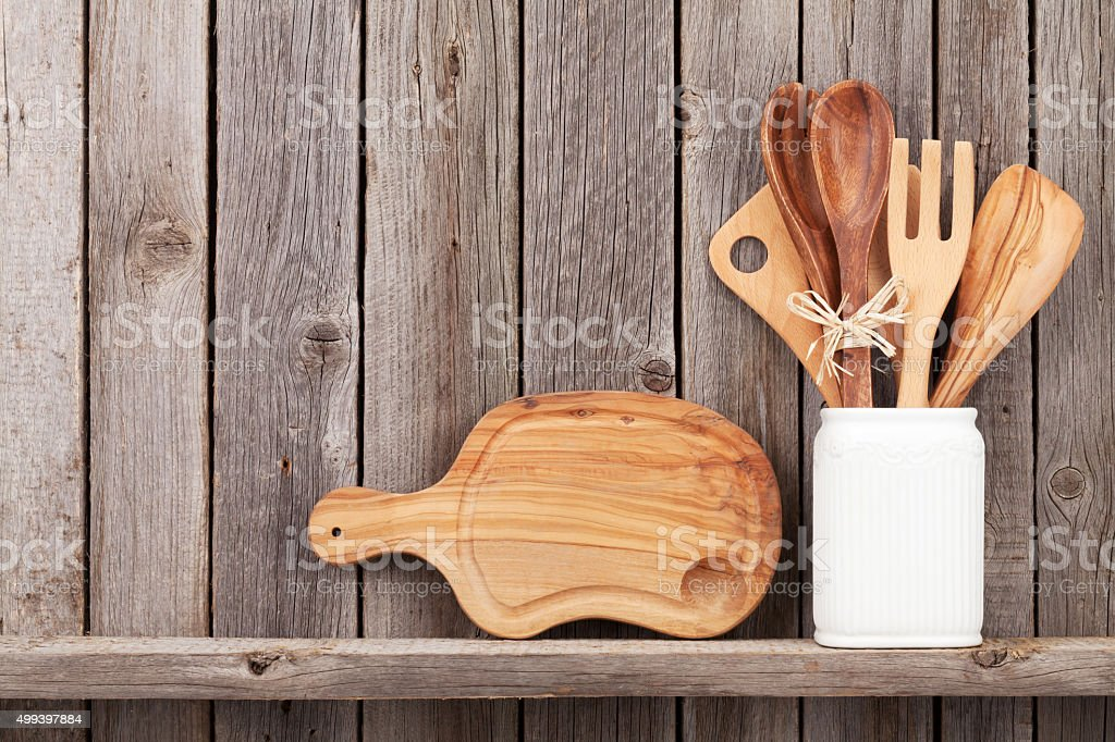 Kitchen cooking utensils on shelf stock photo