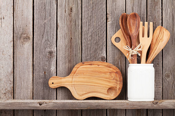 Kitchen cooking utensils on shelf stock photo
