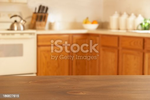 Blurred background of a kitchen. Empty space in foreground for products.