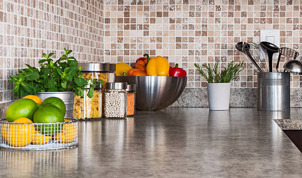 Kitchen countertop with food ingredients and herbs stock photo