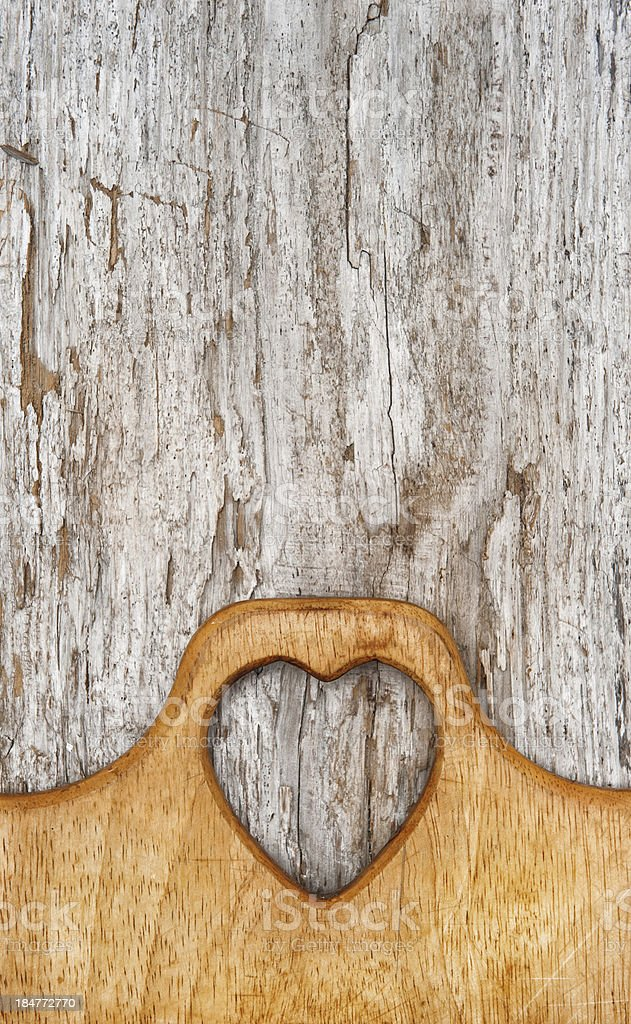 Kitchen cutting board on the old wood background royalty-free stock photo