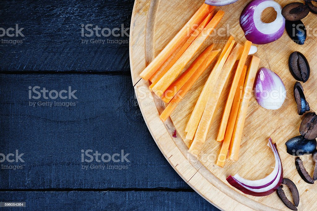 Kitchen cutting board with sliced vegetables royalty-free stock photo