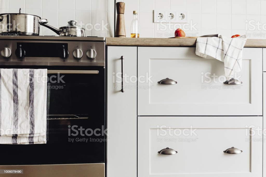 Kitchen Design In Modern Scandinavian Style Stylish Light Grey Kitchen Interior With Modern Furniture And Contemporary Handles And Stainless Steel Appliances In A New House Stock Photo Download Image Now Istock