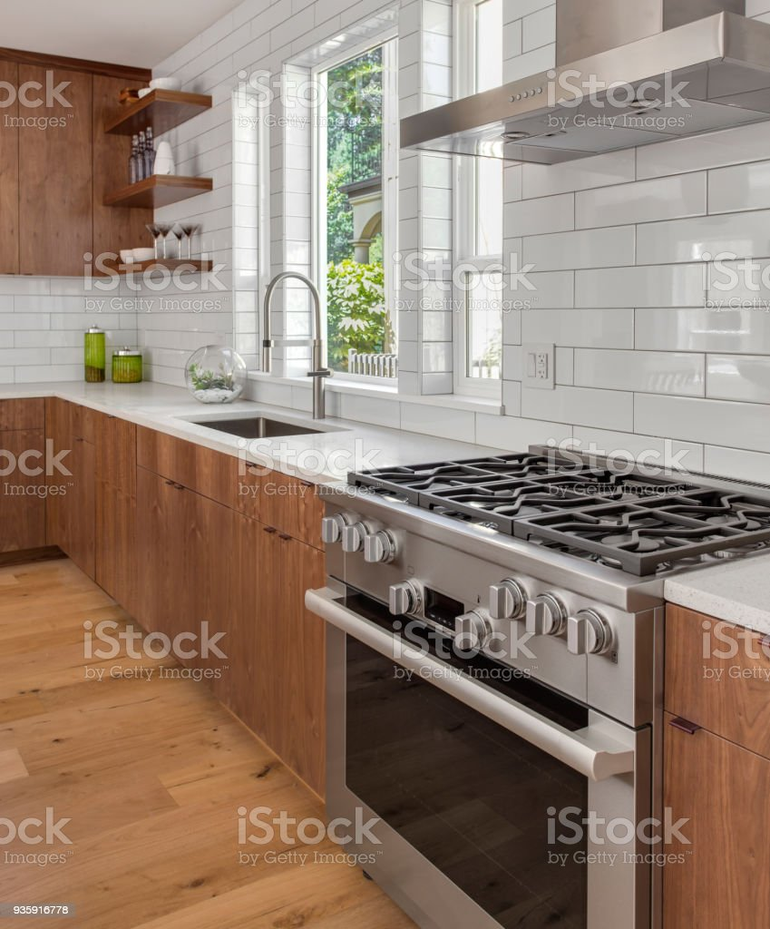 Kitchen detail in new luxury home oven range hood with sink countertops