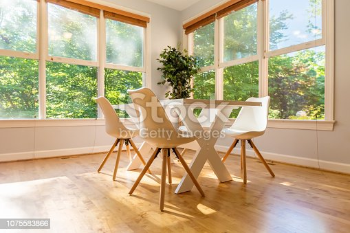 istock Kitchen dining table and chairs bright interior 1075583866
