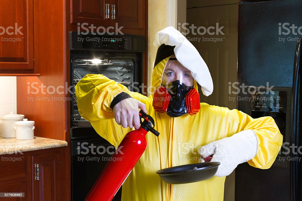 Kitchen Disaster With Hazmat And Fire Extinguisher Stock Photo ...