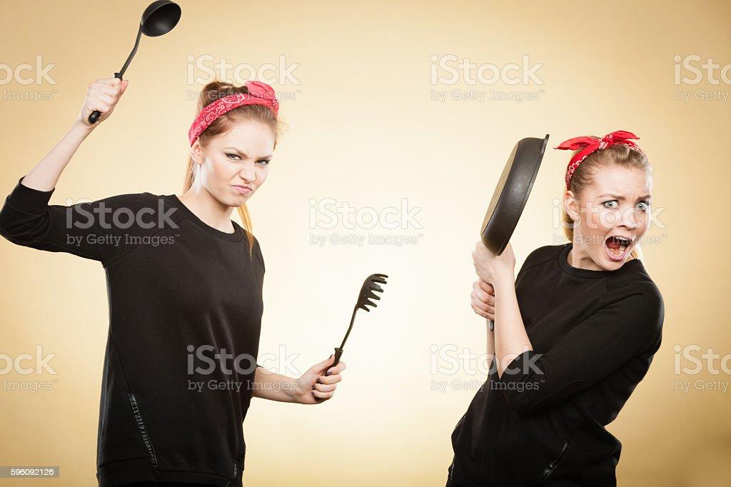 Kitchen fight between retro girls. royalty-free stock photo