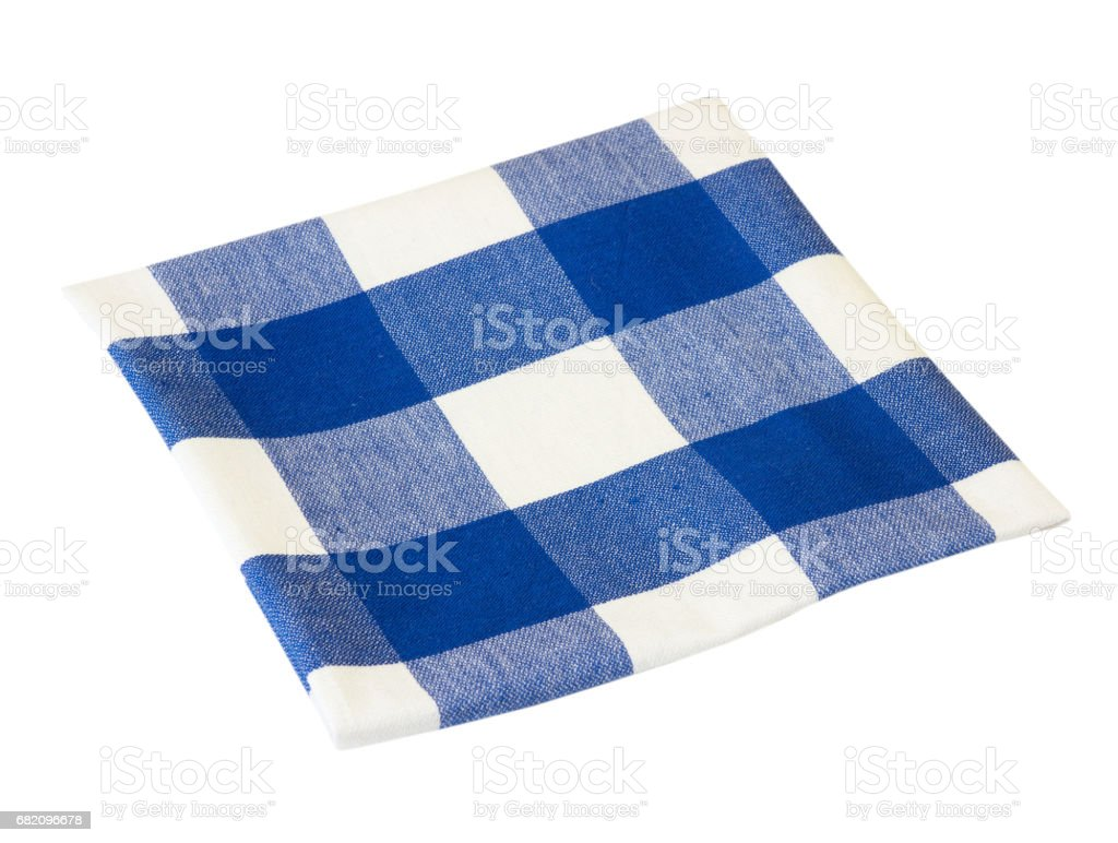 Kitchen folded blue picnic checkered cloth isolated. stock photo