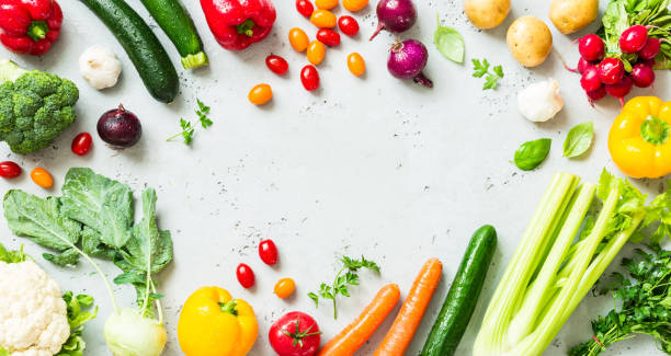 kitchen - fresh colorful organic vegetables on worktop - vegetable stock pictures, royalty-free photos & images