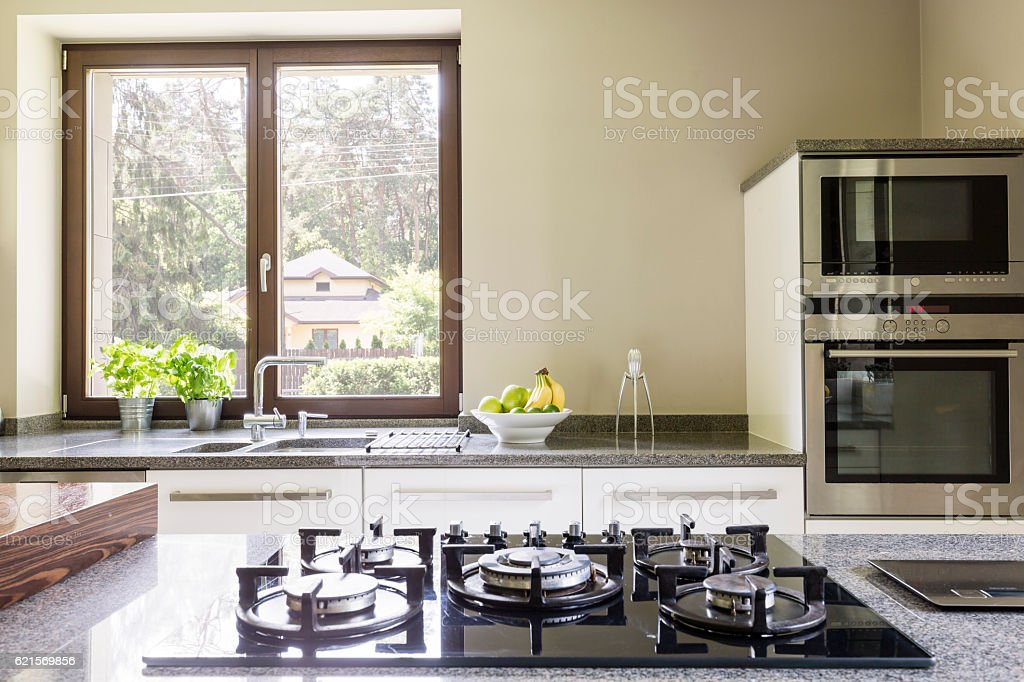 Kitchen granitic worktop with a cooker Lizenzfreies stock-foto