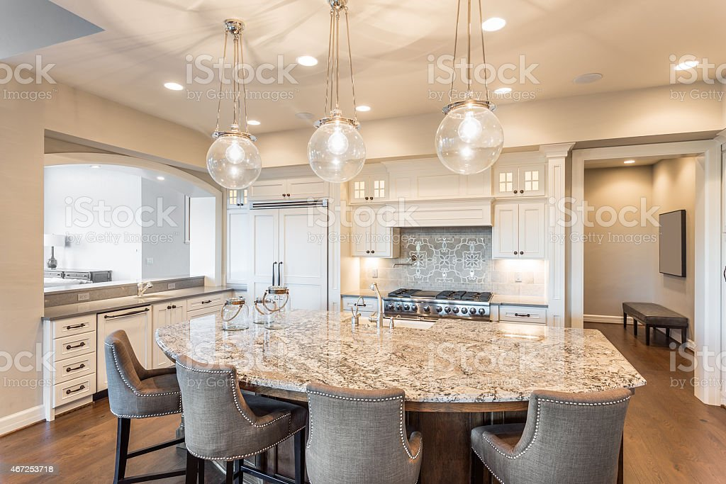 kitchen in luxury home with oak cabinets stock photo   Kitchen In New Luxury Home Stock Photo - Download Image ...