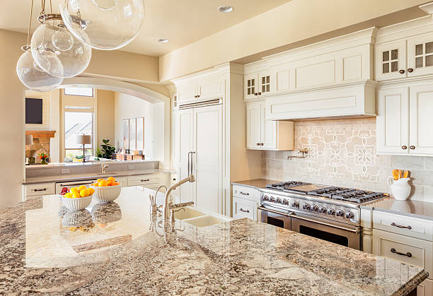 Kitchen in New Luxury Home Kitchen with Island, Sink, Cabinets, and Hardwood Floors quartz stock pictures, royalty-free photos & images