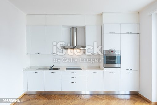 istock Kitchen in newly renovated open space with wooden floors 936398948
