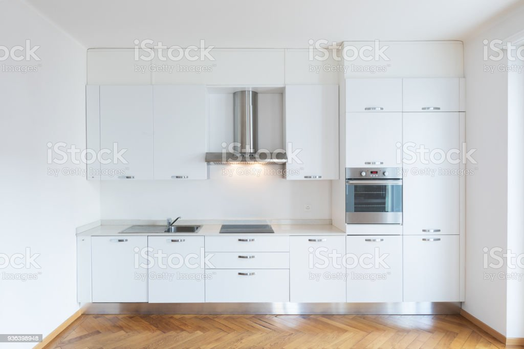 Kitchen in newly renovated open space with wooden floors stock photo