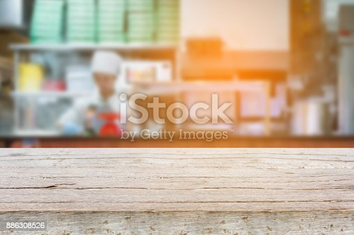 886308526 istock photo kitchen in restaurant blur background 886308526