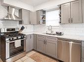 istock Kitchen Interior Design with white back splash stock photo 1276481211