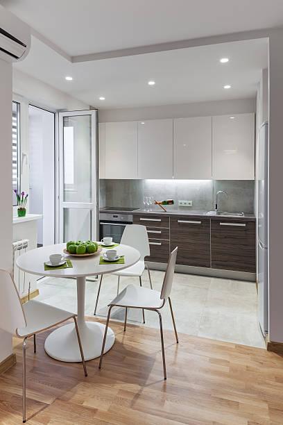 Kitchen interior in modern apartment in scandinavian style stock photo