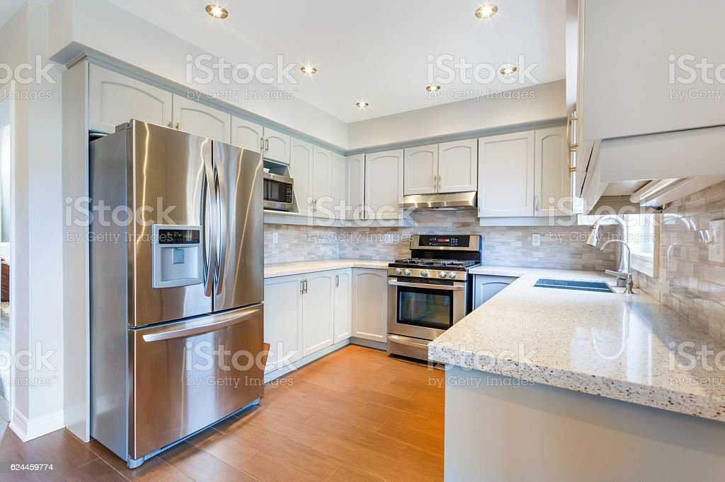 Kitchen interior in new luxury home stock photo