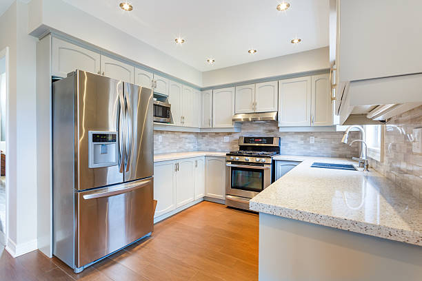 kitchen interior in new luxury home - stainless steel stock pictures, royalty-free photos & images
