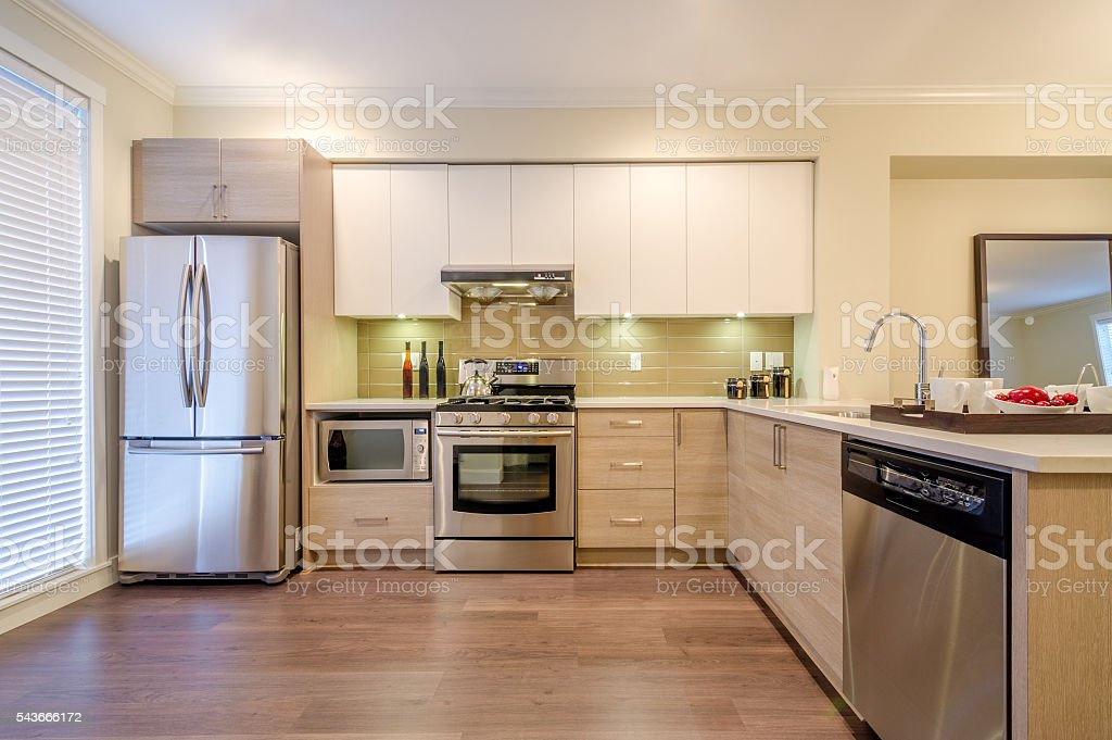 Kitchen interior with stainless steel appliances stock photo