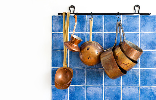 Kitchen interior with vintage copper utensils. old style cookware kitchenware