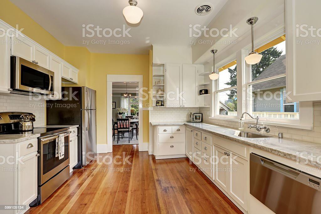 Kitchen Interior With White Cabinets Yellow Walls And Wood Floor Stock Photo Download Image Now Istock