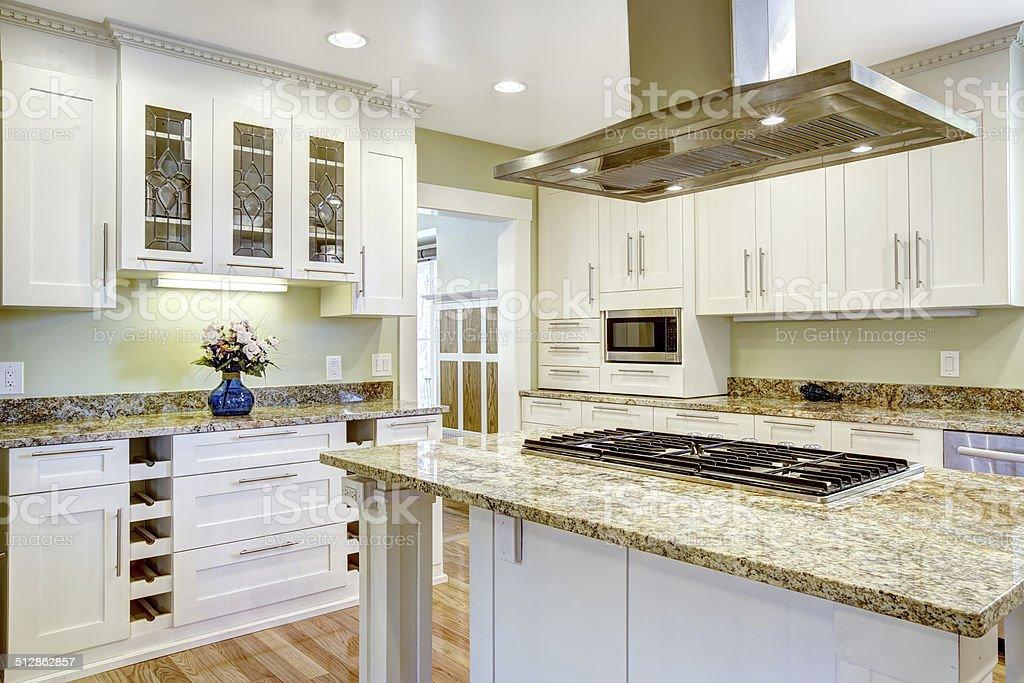 Kitchen Island With Builtin Stove Granite Top And Hood Stock Photo