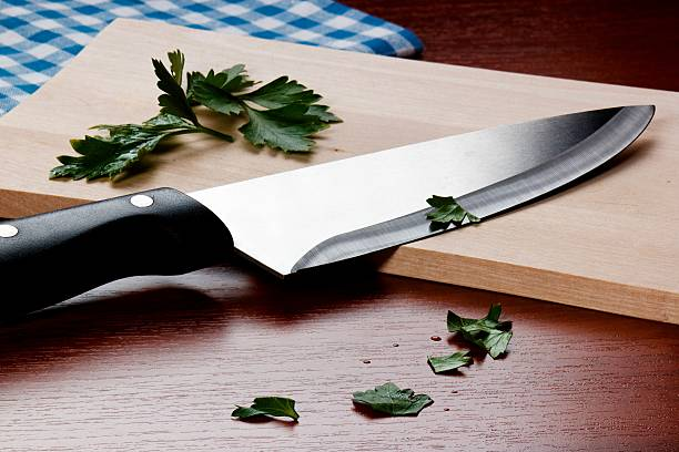 Kitchen Knive on cutting board Kitchen Knive on cutting board kitchen knife stock pictures, royalty-free photos & images