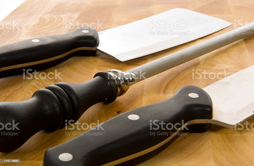 Kitchen Knives on cutting board stock photo