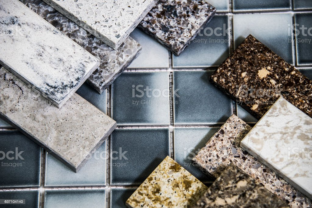 Kitchen natural stone counter samples and floor tiles color samples stock photo