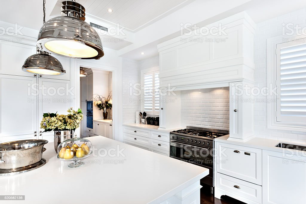 kitchen of luxury and beautiful house with dinning table stock photo