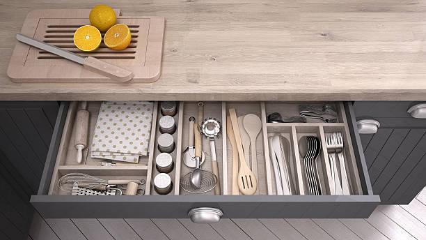 Kitchen opened drawer full of kitchenware stock photo