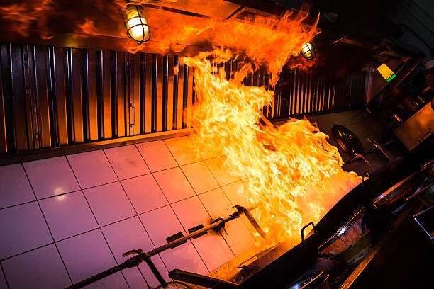 Kitchen pan fire with flames leaping to ceiling stock photo