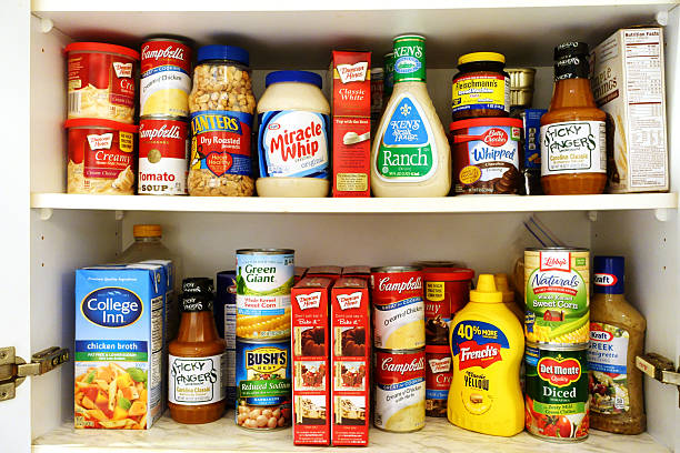 kitchen pantry shelves filled with groceries - inside pantry grocery cupboard bildbanksfoton och bilder