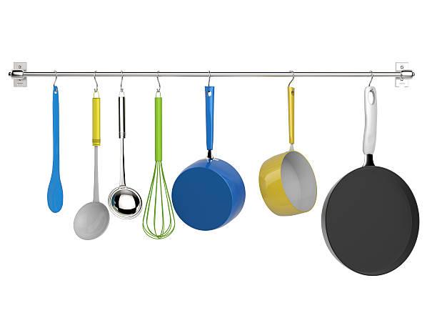 kitchen rack hanging with kitchen utensils - pan keukengereedschap stockfoto's en -beelden