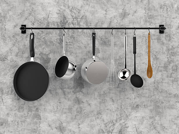 kitchen rack hanging with kitchen utensils - kookgerei stockfoto's en -beelden