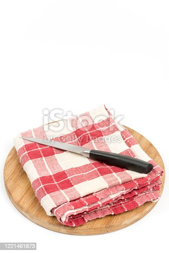 Kitchen red white cloth with knife and wooden board.
