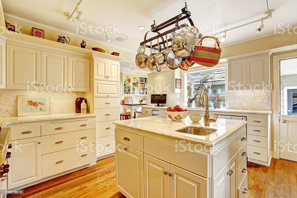 Picture of: Kitchen Room With Island And Hanging Pot Rack Stock Photo Download Image Now Istock