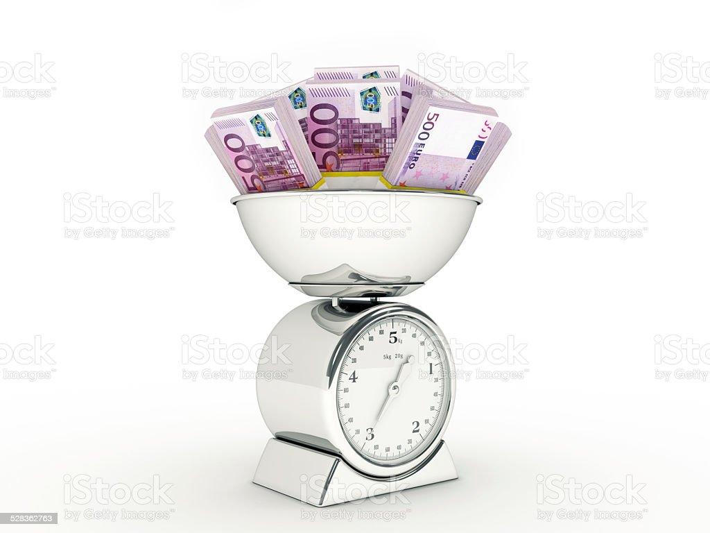Kitchen scale with euro money stock photo