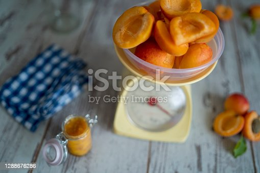 Apricots on the scale. Rustic colorful style image.