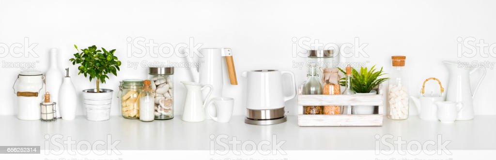 Kitchen shelf full of various utensils isolated on white background stock photo
