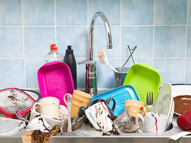 kitchen sink full of dirty dishes  - kitchen sink stock photos and pictures