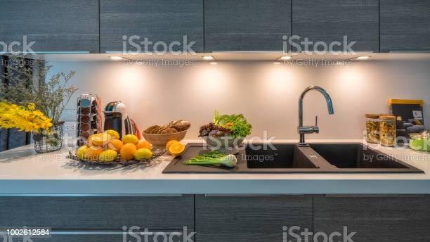 Kitchen sink in modern house kitchen with vegetables internal view of picture id1002612584?b=1&k=6&m=1002612584&s=612x612&h=tumjl2gjr4kt7wcl5o7dvxtuhwomtkqkuseioajlbce=
