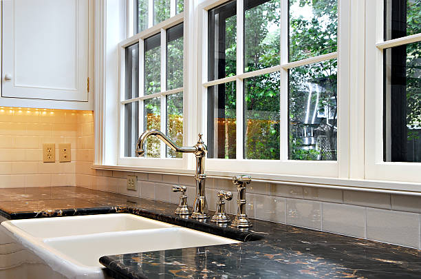 kitchen sink with a view - kitchen sink stock photos and pictures
