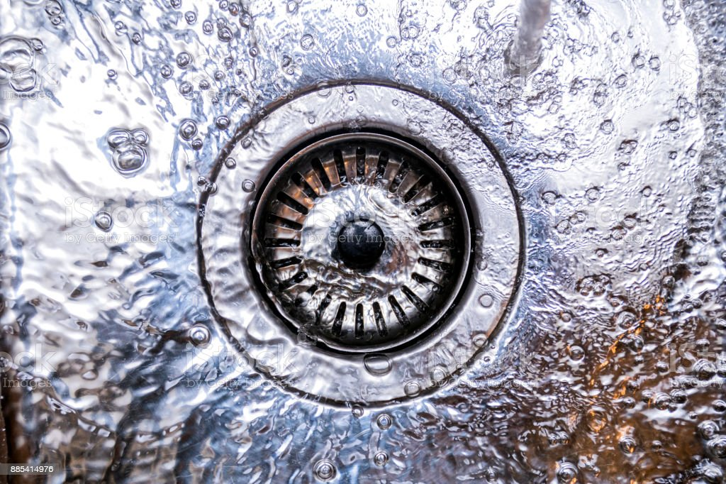 Kitchen sink with running water stock photo