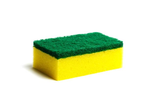 a kitchen sponge isolated on the white background - spugna per le pulizie foto e immagini stock
