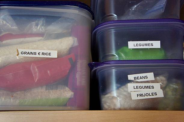 kitchen storage of grains, rice & legumes - küchenorganisation stock-fotos und bilder