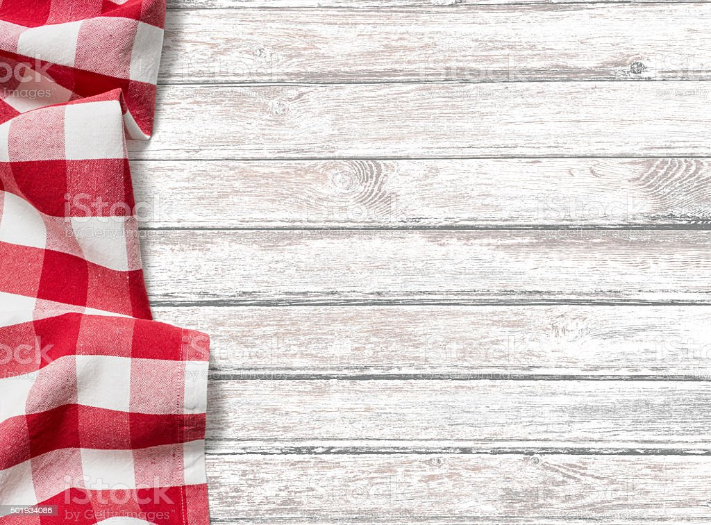 kitchen table background with red picnic cloth stock photo